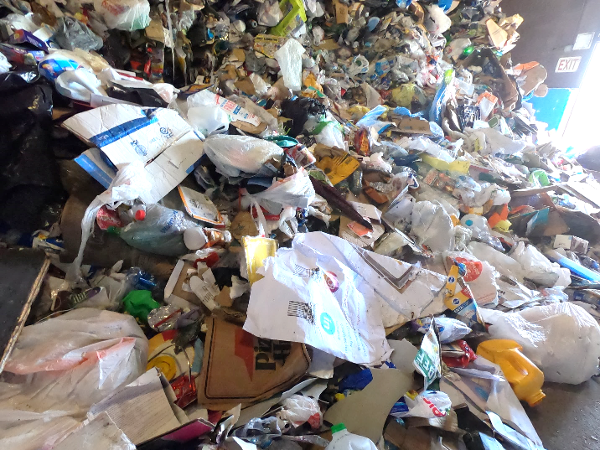 Figure 1 Some materials, like greasy pizza boxes, cannot be recycled, yet still end up in a recycling center.-1_600w